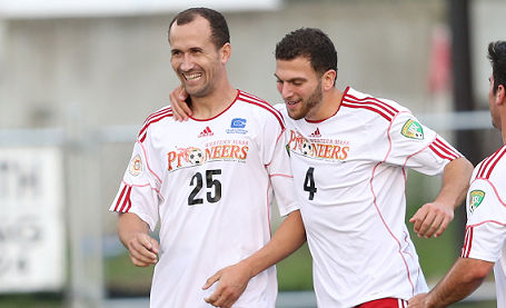 Junior celebrates with teammate Tommaso D'Agostino earlier this season. (Photo: David Henry/sweetdogphotos.com)