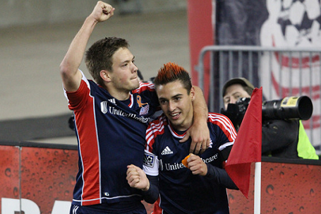 Kelyn Rowe, seen here celebrating with Diego Fagundez earlier this season, netted a pair of goals in Sunday's 5-1 thrashing of the Union. (Photo: Kari Heistad/capturedimages.biz)