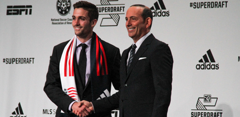 Steve Neumann poses with MLS Commissioner Don Garber after being selected fourth overall by the Revolution in the 2014 MLS SuperDraft. (Photo Courtesy MLSSoccer.com)