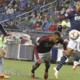 Bunbury and Nguyen score in stoppage time to earn Revolution 2-0 win over defending champions Sporting Kansas City.