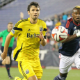 Rhode Island native Michael Parkhurst helps Columbus to 2-1 victory in first game back at Gillette Stadium.